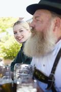 Germany, Bavaria, Upper Bavaria, People in beer garden - stock photo