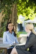 Germany, Bavaria, Upper Bavaria, Two Business women in beer garden Stock Photos