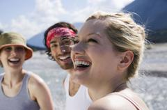 Germany, Tolzer Land, young people at lake, woman laughing - stock photo