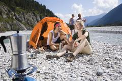 Germany, Bavaria, Tolzer Land, Young friends camping - stock photo