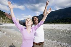 Germany, Bavaria, Tolzer Land, Young couple cheering Stock Photos