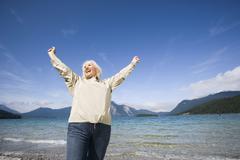 Germany, Bavaria, Walchensee,  Senior woman, cheering - stock photo