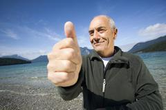 "Germany, Bavaria, Walchensee, senior man giving ""thumbs up"" Stock Photos"