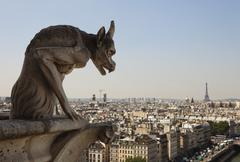 horned gargoyle with eiffel tower - stock photo