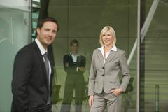 Germany, businesswoman, hands in pocket, with collegues Stock Photos