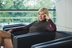 Germany, businesswoman sitting in armchair Stock Photos
