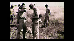 Hunters gathered around shot lion, Tanzania 1937 Stock Footage
