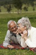Austria, Karwendel, Senior couple relaxing in meadow Stock Photos