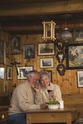 Senior couple sitting at table in Log Cabin - stock photo