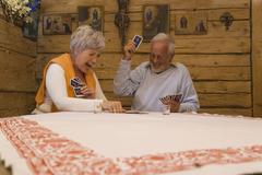 Stock Photo of Senior couple playing cards