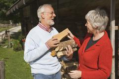 Austria, Karwendel, Senior couple carrying firewood, portrait Stock Photos