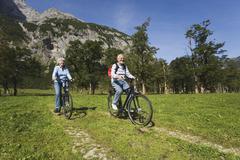 Austria, Karwendel, Senior couple biking Stock Photos