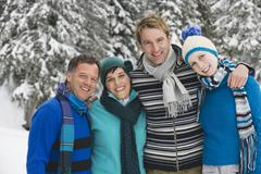 Stock Photo of Italy, South Tyrol, Young people in winter clothes, arm in arm, portrait