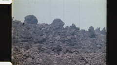 Volcanic rock flow on mountainside. (Vintage 1970's 16mm film footage). Stock Footage