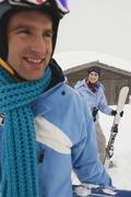 Italy, South Tyrol, Young couple in winter clothes, smiling Stock Photos