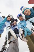 Stock Photo of Italy, South Tyrol, Young people in winter clothes, low angle view