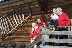 Italy, South Tyrol, Seiseralm, Log Cabin, Couple standing on balcony - stock photo