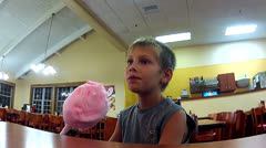 Young boy eating cotton candy. Stock Footage