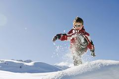 Italy, South Tyrol, Seiseralm, Boy (4-5) playing in snow Stock Photos