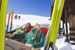 Italy, South Tyrol, Seiseralm, Couple resting in chairs Stock Photos