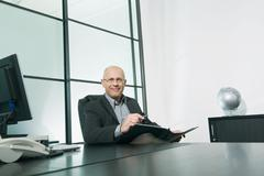 Stock Photo of Germany, Munich, Businessman sitting in office