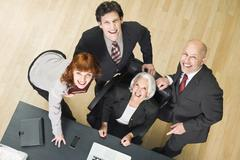 Germany, Munich, Business people, portrait, elevated view - stock photo