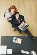 Germany, Munich, Business People in office, using laptop, elevated view Stock Photos