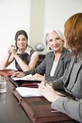 Germany, Munich, Three business women during meeting - stock photo