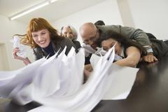 Germany, Munich, Business people in meeting, fooling about Stock Photos