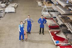 Germany, Neukirch, Instructor and apprentices standing in industrial hall, Stock Photos
