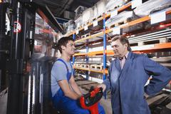 Germany, Neukirch, Apprentice and foreman in storeroom Stock Photos