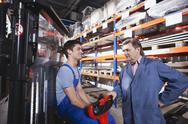 Stock Photo of Germany, Neukirch, Apprentice and foreman in storeroom