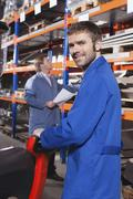 Germany, Neukirch, Foreman and apprentice in storeroom Stock Photos