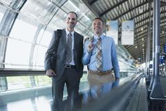 Germany,  Leipzig-Halle, Airport, Two Business people on travelator - stock photo