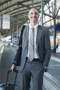 Germany, Leipzig-Halle, Airport, Businessman in departure lounge Stock Photos