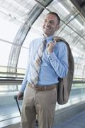 Germany, Leipzig-Halle, Airport, Businessman in departure lounge - stock photo