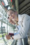Stock Photo of Germany, Leipzig-Halle, Airport, Businessman and businesswoman, laughing,