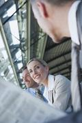 Germany, Leipzig-Halle, Airport, Business people, waiting, portrait - stock photo