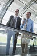 Germany, Leipzig-Halle, Airport, Two businessmen on moving floor Stock Photos