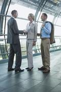 Germany, Leipzig-Halle, Airport, Business people shaking hands - stock photo