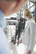 Germany, Leipzig-Halle, Airport, Business people with suitcase Stock Photos