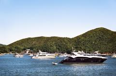 Luxury boats anchored in a bay off Hong Kong Island - stock photo