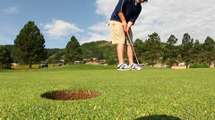 Putt that goes into hole. Stock Footage