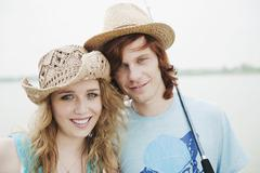 Germany, Bavaria, Ammersee, Young couple, portrait, Ammersee in background - stock photo