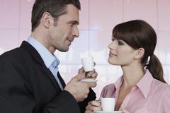 Germany, Cologne, Couple drinking espresso, portrait Stock Photos
