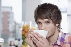 Stock Photo of Germany, Cologne, Young man in cafe
