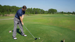 Professional Golfer Teeing Off Start of Hole Stock Footage
