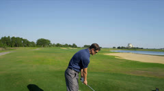 Young Caucasian Male Playing Golf Stock Footage