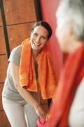Two women in changing room, smiling, portrait Stock Photos