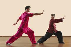 Kung Fu, Changquan, Gongbu, Long Fist Style, Kung fu instructor and boy (10-11) - stock photo